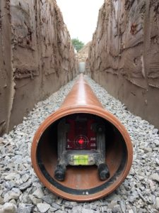 Drainage being laid using a pipe laser